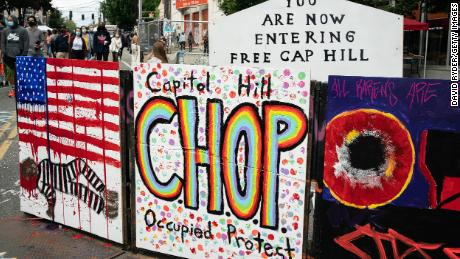 "SEATTLE, WA - JUNE 14: A signs reads ""Capitol Hill Occupied Protest"" in area that has been referred to by protesters by that name as well as ""Capitol Hill Organized Protest, or CHOP, on June 14, 2020 in Seattle, Washington. Black Lives Matter protesters have continued demonstrating in what was first referred to as the Capitol Hill Autonomous Zone, which encompasses several blocks around the Seattle Police Departments vacated East Precinct, but what protesters are now calling the ""Capitol Hill Organized Protest."" (Photo by David Ryder/Getty Images)"