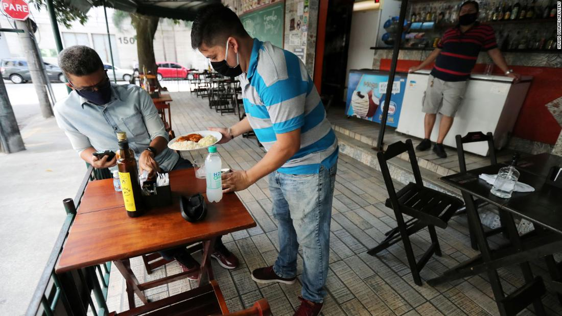 'Sending the population to the slaughterhouse': Restaurants and bars open in Rio amid pandemic
