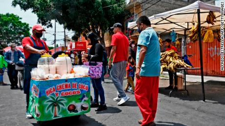 People are seen at a popular street market known locally as a tianguis in  Mexico City on July 2, 2020 as the country authorized the reopening of restaurants, shops, street markets and sport complexes.