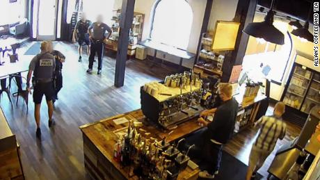 An Oregon State Trooper is on administrative leave after four troopers defy state's mask mandate in coffee shop.