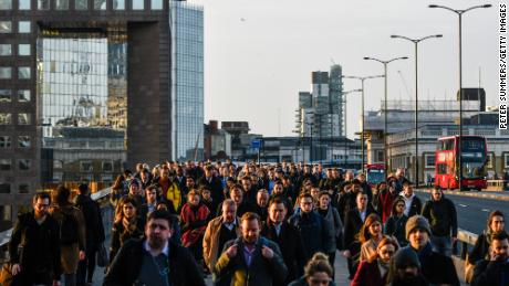 Commuters walk across London Bridge on February 3, 2020. The city went into lockdown on March 24.