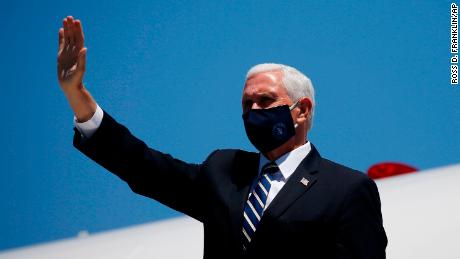 Vice President Mike Pence waves as he arrives in Phoenix to meet with Arizona Republican Gov. Doug Ducey to discuss the surge in coronavirus cases Wednesday, July 1, 2020. (AP Photo/Ross D. Franklin)