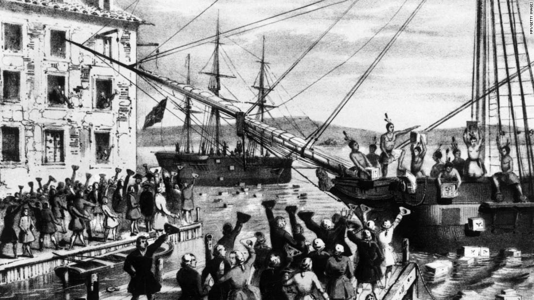 A group of Bostonians dressed as Native Americans dump crates of imported British tea into Boston Harbor as a protest against the British Tea Act in 1773.