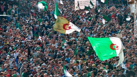 Algerians take part in an anti-government demonstration in Algiers on November 1, 2019, timed to coincide with official celebrations of the anniversary of the war that won Algeria's independence from France.