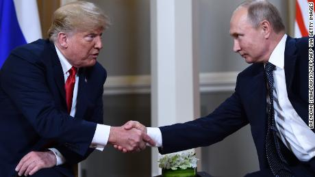 Russian President Vladimir Putin (R) and US President Donald Trump shake hands before a meeting in Helsinki, on July 16, 2018. (Photo by Brendan Smialowski / AFP)        (Photo credit should read BRENDAN SMIALOWSKI/AFP via Getty Images)