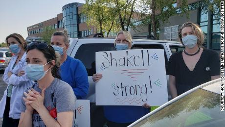 Healthcare workers celebrate Shakell Avery's recovery outside Menorah Medical Center on June 30.