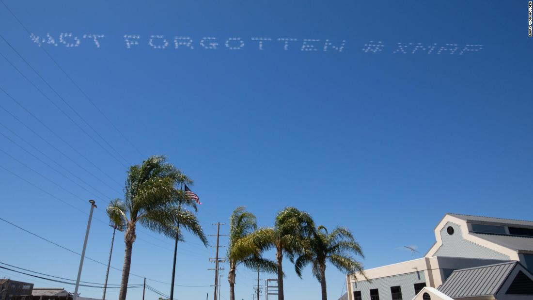 80 American artists are writing messages in the skies above ICE detention centers