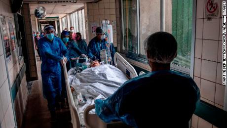Nurses move a Covid-19 patient to a critical care unit at a hospital in Santiago, Chile , June 24, 2020.