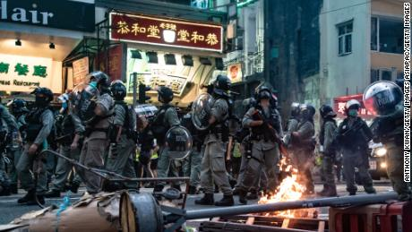 Riot police are seen in front of a burning road block during a protest against the new national security law on July 1, 2020, in Hong Kong.