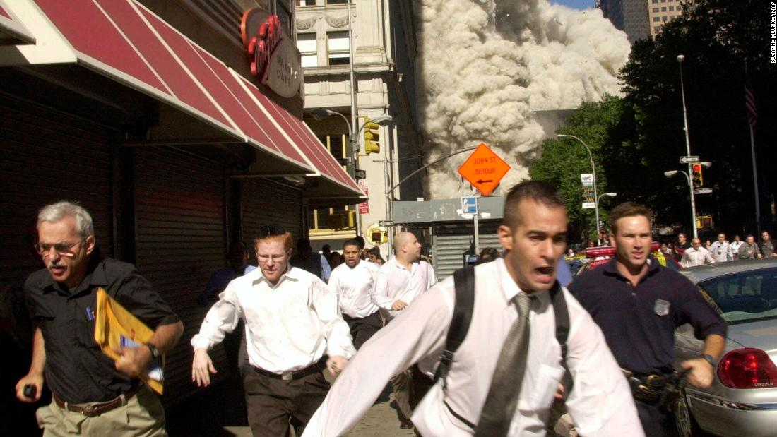 Man in famous 9/11 photo dies of Covid-19, his family says