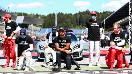 "AlphaTauri's French driver Pierre Gasly (2L), Mercedes' British driver Lewis Hamilton and Ferrari's German driver Sebastian Vettel kneel ahead the Austrian Formula One Grand Prix race on July 5, 2020 in Spielberg, Austria in solidarity with the ""Black Lives Matter"" movement. (Photo by Dan ISTITENE / POOL / AFP) (Photo by DAN ISTITENE/POOL/AFP via Getty Images)"