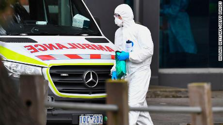 An ambulance is seen outside one of nine public housing estates locked down due to a spike in COVID-19 coronavirus numbers in Melbourne on July 6.