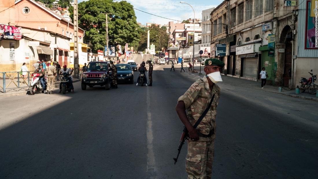 Mandatory Credit: Photo by Henitsoa Rafalia/EPA-EFE/Shutterstock (10592097c) A member of the National Defense Force mas a check point, as part of measures put in place to combat the spread of coronavirus and COVID-19 in Antananarivo, Madagascar, 23 March (issued 24 March 2020). According to media reports, President of Madagascar Andry Rajoelina, implemented lock downs in Antananarivo and Toamasina, two of the nations largest cities. Coronavirus in Madagascar, Antananarivo - 23 Mar 2020
