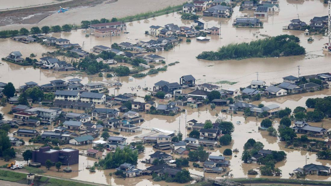 This picture shows inundated houses due to heavy rain in Hitoyoshi, Kumamoto prefecture on July 4, 2020. - Fourteen people were feared dead at a nursing home in western Japan on July 4 as record rainfall triggered massive floods and landslides, forcing authorities to issue evacuation advisories for more than 200,000 residents. (Photo by STR / JIJI PRESS / AFP) / Japan OUT (Photo by STR/JIJI PRESS/AFP via Getty Images)