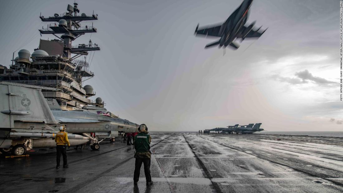 200704-N-ML137-1021  SOUTH CHINA SEA (July 4, 2020) An F/A-18E Super Hornet flies over the flight deck of the Navy's only forward-deployed aircraft carrier USS Ronald Reagan (CVN 76), maintaining Ronald Reagan's tactical presence on the seas. Ronald Reagan is the flagship of Carrier Strike Group (CSG) 5. The Nimitz and Ronald Reagan CSGs are conducting dual-carrier operations as the Nimitz Carrier Strike Force. (U.S. Navy photo by Mass Communication Specialist 2nd Class Samantha Jetzer/Released)