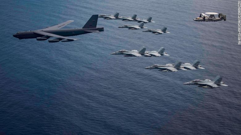 Aircraft from the Nimitz Carrier Strike Force and a B-52 Bomber from Barksdale Air Force Base in Louisiana fly over the South China Sea.