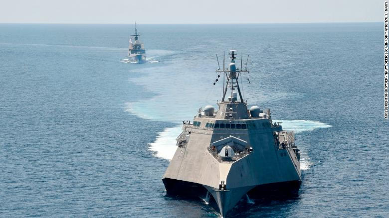 The littoral combat ship USS Gabrielle Giffords, front, exercises with the Republic of Singapore Navy Fmulti-role stealth frigate RSS Steadfast in the South China Sea, May 25, 2020.