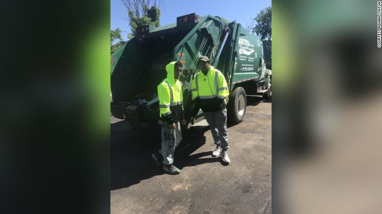 Rehan Staton, left, with his brother Reggie when they both worked at Bates Trucking Trash Removal Inc.
