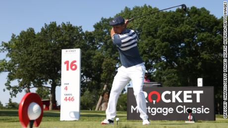 DeChambeau tees off on the 16th hole of the final round of the Rocket Mortgage Classic in Detroit.