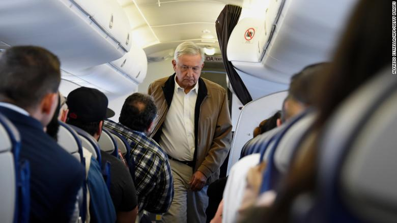 Mexican President Andres Manuel Lopez Obrador boards a commercial flight bound for Culiacan at Mexico City's international airport, on Feb. 15, 2019.