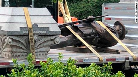 The statue of a Confederate soldier and plinth sit on a flatbed truck at the Old Capitol in Raleigh, North Carolina, on Sunday, June 21.