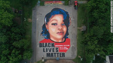 Artists and volunteers painted a 7,000-square-foot mural of Breonna Taylor Over the Fourth of July weekend