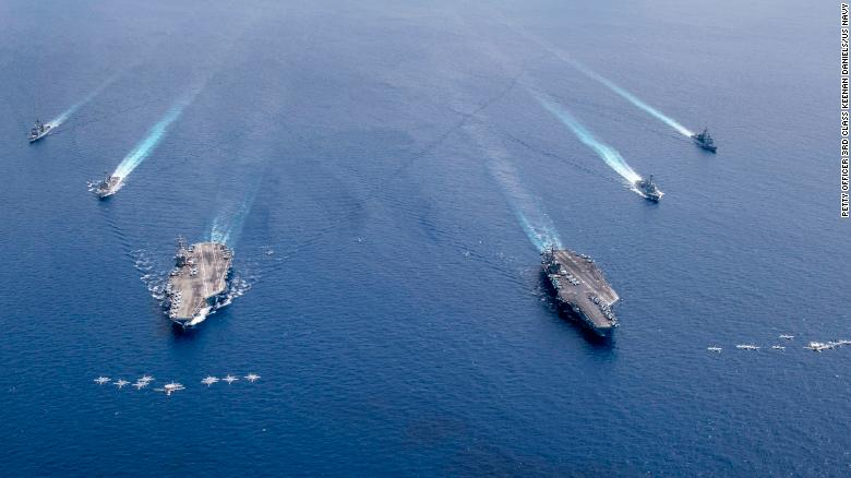 The Nimitz Carrier Strike Force composed of the USS Nimitz and USS Ronald Reagan Carrier Strike Groups conduct dual carrier operations in the South China Sea on Monday.