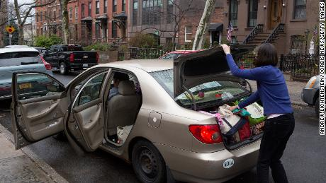 A Brooklyn family prepares to leave the city due to concerns about the spread of the Covid-19 on March 25, 2020.