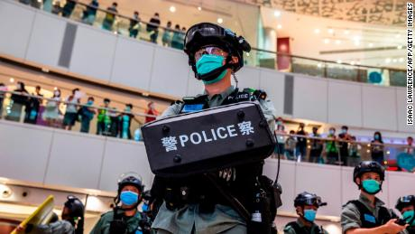 A riot police officer stands guard during a clearance operation during a demonstration in a mall in Hong Kong on July 6, 2020, in response to a new national security law introduced in the city.