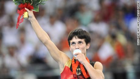 Germany's Oksana Aleksandrovna Chusovitina stands on the podium during the medal ceremony of the women's vault final of the artistic gymnastics event of the Beijing 2008 Olympic Games in Beijing on August 17, 2008.   North Korea's Un Jong Hong won the gold, Germany's Oksana Aleksandrovna Chusovitina the silver and China's Fei Cheng the bronze.   AFP PHOTO / LLUIS GENE (Photo credit should read LLUIS GENE/AFP via Getty Images)