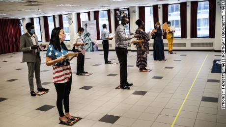 People are sworn in as new American citizens during a ceremony at the U.S. Citizenship and Immigration Services New York Field Office on July 2 in New York City.