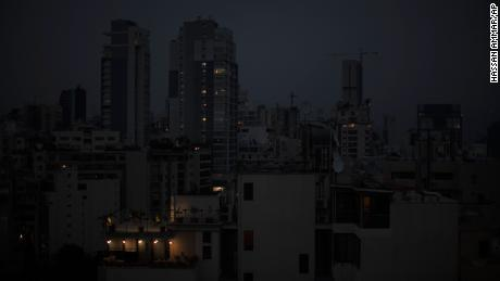 The capital city of Beirut remains in darkness during a power outage on Monday, July 6, 2020.