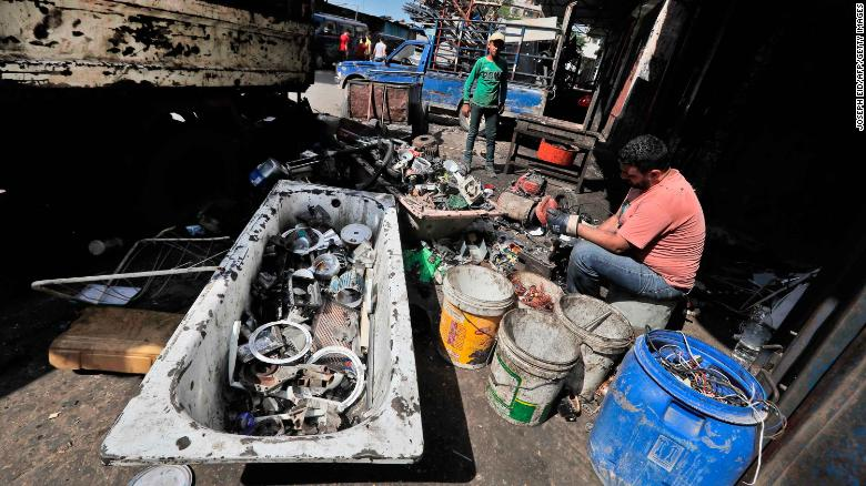 A man dismantles and sorts through discarded electric devices at a scrap workshop in the Bab al-Tabbaneh neighborhood of Lebanon's northern city of Tripoli on June 3, 2020.