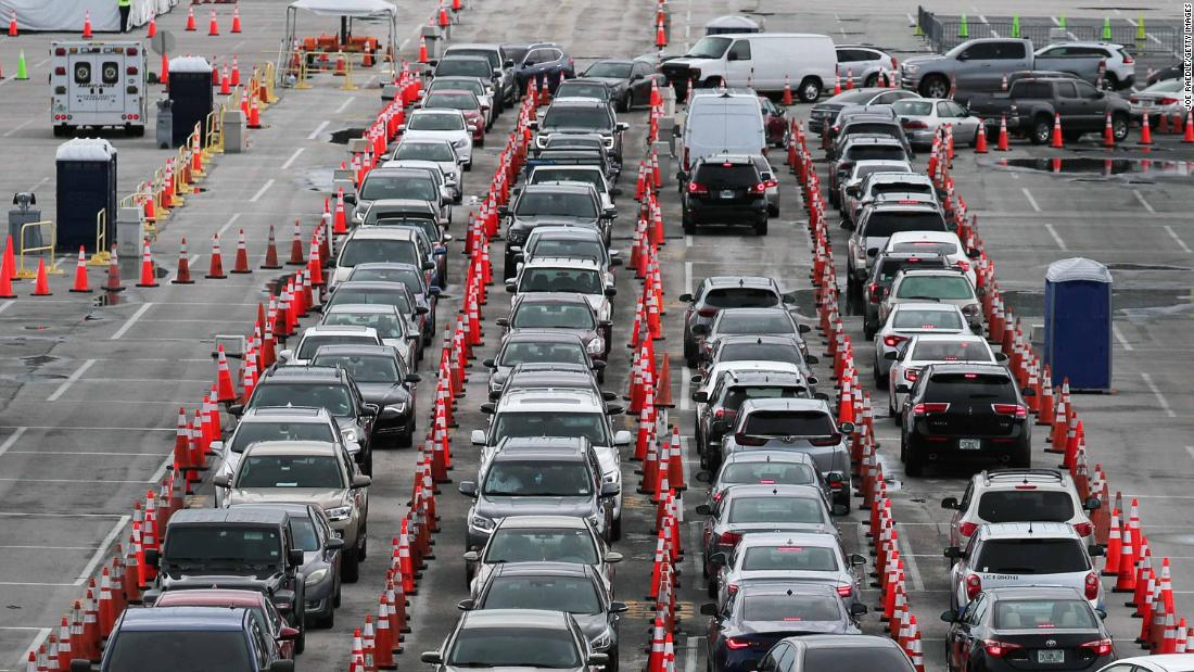 Cars line up in the Hard Rock Stadium parking lot so drivers could be tested in Miami Gardens, Florida, on July 6.