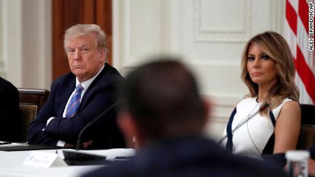 "President Donald Trump and first lady Melania Trump listen during a ""National Dialogue on Safely Reopening America's Schools,"" event in the East Room of the White House, Tuesday, July 7, 2020, in Washington. (AP Photo/Alex Brandon)"