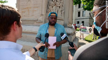 Vauhxx Booker speaks in front of the Monroe County Courthouse during a demonstration.