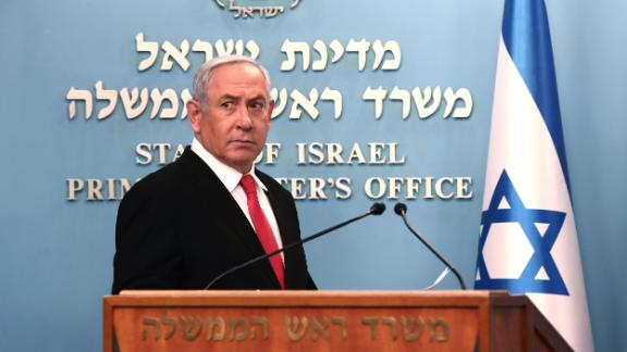 """Mandatory Credit: Photo by GALI TIBBON/POOL/EPA-EFE/Shutterstock (10583327g) Israeli Prime Minister Benjamin Netanyahu gives a speech regarding the new measures that will be taken to fight the Corona virus in Israel, at his Jerusalem office, 14 March 2020. Netanyahu said Israel would shut down eateries, shopping centres and gyms in a bid to halt the spread of coronavirus. Netanyahu also said he would ask the government's approval in the upcoming cabinet meeting set to be held via video conference to allow """"technologies used in the war against terror"""" to be used to track the movements of Israelis with coronavirus. Coronavirus in Israel, Jerusalem - 14 Mar 2020"""