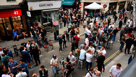 Londoners congregate in Soho, as coronavirus lockdown restrictions eased across the UK on July 4 allowing pubs and restaurants to reopen.
