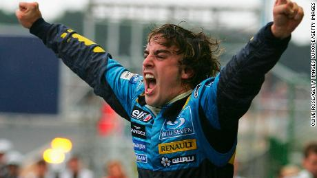 Alonso celebrates winning the world whampionship after finishing third in the Brazilian Grand Prix at the Autodromo Interlagos on September 25, 2005 in Sao Paulo, Brazil.