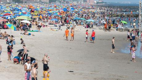 People visit the crowded beach at Coney Island as the city moves into Phase 2 of re-opening following restrictions imposed to curb the coronavirus pandemic in Brooklyn, New York, on July 4.