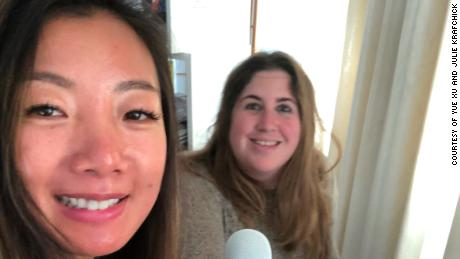 Yue Xu and Julie Krafchick take a selfie while hosting their podcast.