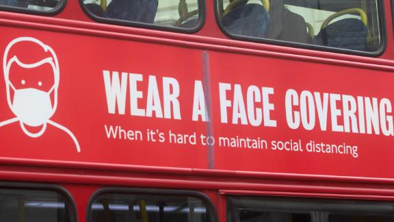 Mandatory Credit: Photo by Amer Ghazzal/Shutterstock (10670420c) A sign on a London bus advising people to wear face coverings. The government and department of transport has announced the face coverings will become mandatoay on public tranport Face coverings to become mandatory on public transport, Wimbledon, London, UK - 05 Jun 2020