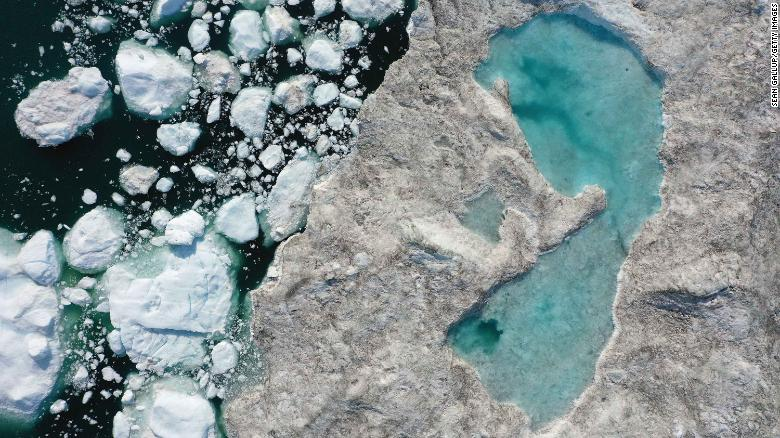 ILULISSAT, GREENLAND - In this aerial view melting ice forms a lake on free-floating ice jammed into the Ilulissat Icefjord during unseasonably warm weather on July 30, 2019 near Ilulissat, Greenland.