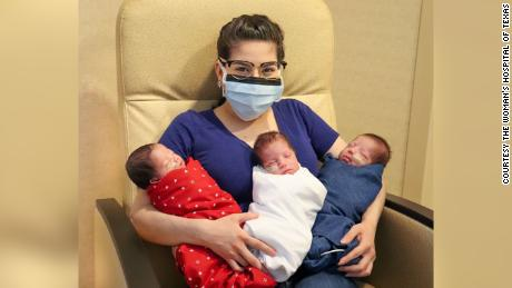 Maggie Sillero holds her triplets, who have almost doubled in size since they were born on June 4.