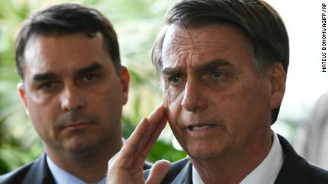 Jair Bolsonaro accompanied by his son Flavio in November 2018.