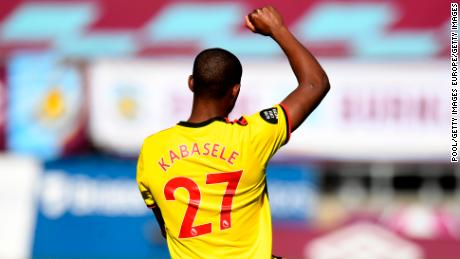 BURNLEY, ENGLAND - JUNE 25: Christian Kabasele of Watford takes a knee in support of the Black Lives Matter movement prior to the Premier League match between Burnley FC and Watford FC at Turf Moor on June 25, 2020 in Burnley, United Kingdom. (Photo by Peter Powell/Pool via Getty Images)