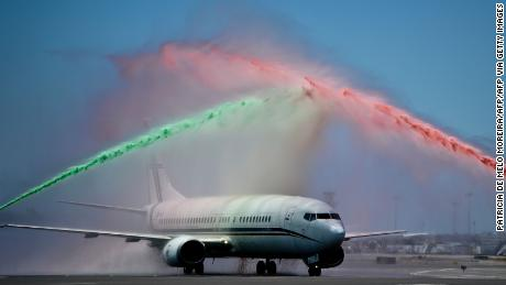 Firefighter's spray water in Portugal's national colors as the team return from France.