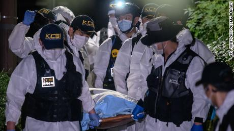 A forensic team carries the body of Park Won-soon on July 10, 2020.