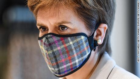 Scotland's first minister, Nicola Sturgeon, wears a Tartan face mask when she visits a shopping park last month in Edinburgh.