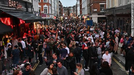 Revelers pack a street outside bars in the Soho area of London on July 4, as restrictions are further eased.